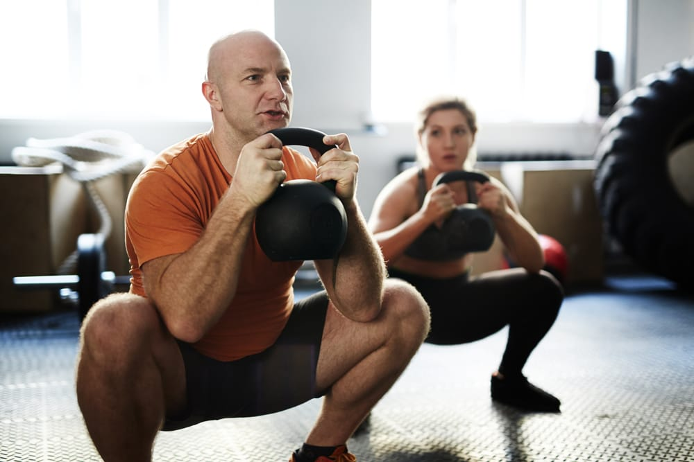 how to kettlebell squat exercise